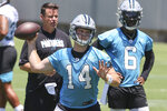 Carolina Panthers quarterback Sam Darnold (14) throws a pass as quarterback PJ Walker (6) looks on during NFL football practice in Charlotte, N.C., Tuesday, June 15, 2021. (AP Photo/Nell Redmond)