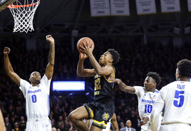 Wichita State's Grant Sherfield goes to the basket against Memphis' D.J. Jeffries (0) during the first half of an NCAA college basketball game Thursday, Jan. 9, 2020, in Wichita, Kan. (Travis Heying/The Wichita Eagle via AP)