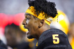 Arizona State quarterback Jayden Daniels (5) looks on from the sidelines in the second half during an NCAA college football game against BYU Saturday, Sept. 18, 2021, in Provo, Utah. (AP Photo/Rick Bowmer)