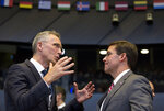 NATO Secretary General Jens Stoltenberg, left, speaks with acting U.S. Secretary for Defense Mark Esper during a meeting of the coalition to defeat Islamic State militants at NATO headquarters in Brussels, Thursday, June 27, 2019. (AP Photo/Virginia Mayo, Pool)