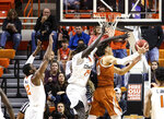 Texas forward Jaxson Hayes attempts a reverse layup against Oklahoma State's Yor Anei during the first half of an NCAA college basketball game Tuesday, Jan. 8, 2019, in Stillwater, Okla. (Evan Brown/Tulsa World via AP)