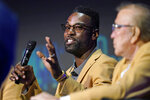 Calvin Johnson, center, speaks as members of the Pro Football Hall of Fame Class of 2021, participated in an enshrinees' roundtable in Canton, Ohio, Sunday, Aug. 8, 2021. (AP Photo/Gene J. Puskar)