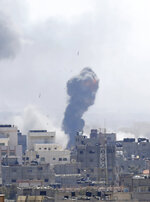 Israeli airstrike hits Gaza City, Saturday, May 4, 2019. Palestinian militants in the Gaza Strip fired at least 90 rockets into southern Israel on Saturday, according to the Israeli military, triggering retaliatory airstrikes and tank fire against militant targets in the blockaded enclave and shattering a month-long lull in violence. (AP Photo/Hatem Moussa)