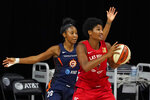 Las Vegas Aces forward Angel McCoughtry (35) goes up against Connecticut Sun guard Briann January (20) during the second half of Game 4 of a WNBA basketball semifinal round playoff series Sunday, Sept. 27, 2020, in Bradenton, Fla. (AP Photo/Chris O'Meara)