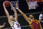 Oklahoma forward Brady Manek (35) goes up for a rebound next to Iowa State forward George Conditt IV (4) during the first half of an NCAA college basketball game in the first round of the Big 12 men's tournament in Kansas City, Mo., Wednesday, March 10, 2021. (AP Photo/Orlin Wagner)