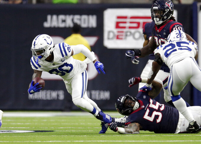Indianapolis Colts wide receiver Chester Rogers (80) runs past Houston Texans inside linebacker Benardrick McKinney (55) after making a catch during the first half of an NFL wild card playoff football game, Saturday, Jan. 5, 2019, in Houston. (AP Photo/Michael Wyke)