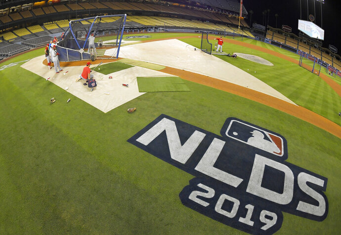 Members of the Washington Nationals practice for Game 1 of the NLDS baseball game against the Los Angeles Dodgers, Wednesday, Oct. 2, 2019, in Los Angeles. (AP Photo/Mark J. Terrill)