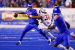Boise State quarterback Jaylon Henderson, left, looks to throw the ball as New Mexico linebacker Alexander Vainikolo, right, tries to pull him down during the second half of an NCAA college football game Saturday, Nov. 16, 2019, in Boise, Idaho. Boise State won 42-9.(AP Photo/Steve Conner)