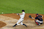 New York Yankees DJ LeMahieu hits an eighth-inning single next to Boston Red Sox catcher Kevin Plawecki during a baseball game Sunday, Aug 2, 2020, in New York. (AP Photo/Kathy Willens)