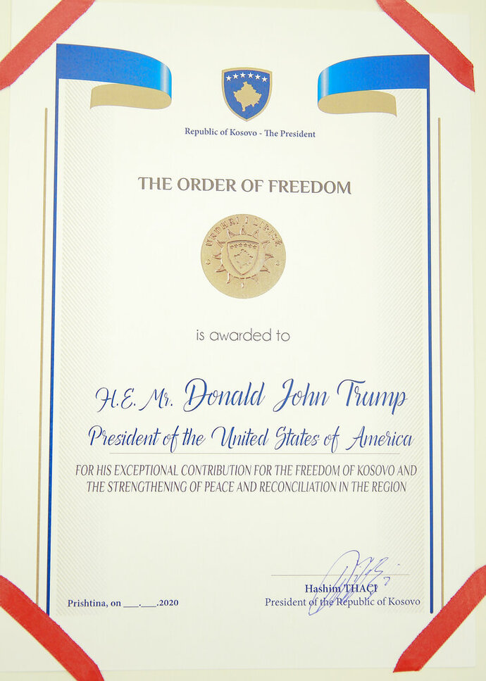 A photo of the Order of Freedom awarded to the U.S President Donald Trump, undersigned by Kosovo's President Hashim Thaci in capital Pristina, Kosovo on Friday, Sept. 18, 2020. Kosovo's president awarded U.S. President Donald Trump with one of the country's highest medals - Kosovo's Order of Freedom - for his government's efforts on peace and reconciliation in the former war-torn region. (AP Photo/Visar Kryeziu)