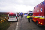 Emergency workers attend the scene after a passenger bus collided with a truck Wednesday Nov. 13, 2019, near the town of Nitranske Hrnciarovce, Slovakia, Wednesday Nov. 13, 2019. Officials say at least 13 people have died in the accident with about 20 injured, some seriously.  (HaZZ-Presidium of Fire and Rescue Corps via AP)
