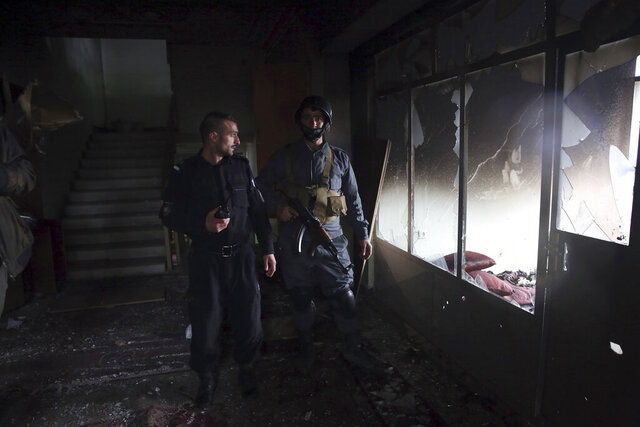 FILE- in this Wednesday, March 25, 2020, photo, security personnel inspect a Sikh house of worship in the aftermath of a deadly attack in Kabul, Afghanistan. Pakistan asked neighbor Afghanistan to extradite Aslam Farooqi, a leader of the local Islamic State affiliate, who was arrested in an Afghan intelligence operation in southern Afghanistan earlier this month. (AP Photo/Rahmat Gul, file)