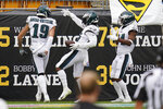 Philadelphia Eagles running back Miles Sanders, center, celebrates his touchdown during the first half of an NFL football game against the Pittsburgh Steelers, Sunday, Oct. 11, 2020, in Pittsburgh. (AP Photo/Keith Srakocic)