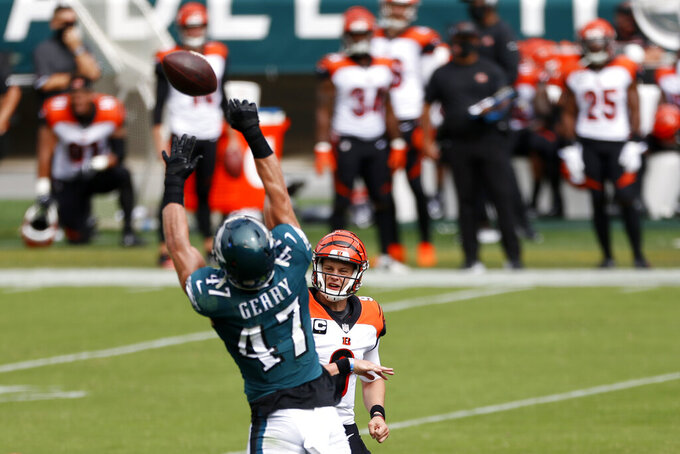Cincinnati Bengals' Joe Burrow, right, cannot get a pass past Philadelphia Eagles' Nathan Gerry during the first half of an NFL football game, Sunday, Sept. 27, 2020, in Philadelphia. (AP Photo/Laurence Kesterson)