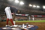 Washington Nationals' Victor Robles is seen in the on deck circle during the fourth inning of Game 3 of the baseball National League Championship Series against the St. Louis Cardinals Monday, Oct. 14, 2019, in Washington. (AP Photo/Jeff Roberson)