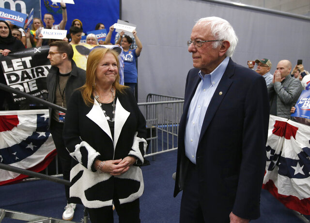 Democratic presidential candidate Sen. Bernie Sanders I-Vt., waits, with his wife Jane, left, as protestors who interrupted his campaign event were removed from the stage, in Carson City, Nev., Sunday, Feb. 16, 2020. Sanders returned after the demonstrator's were removed. (AP Photo/Rich Pedroncelli)