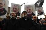 Protester gather during a demonstration against the killing of Iranian Revolutionary Guard Gen. Qassem Soleimani, seen in posters, close to United States' consulate in Istanbul, Sunday, Jan. 5, 2020. Iran has vowed