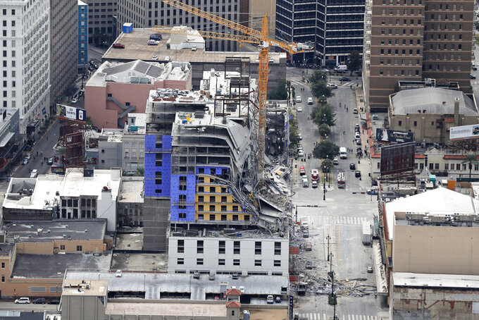 FILE - This Oct. 12, 2019, file aerial photo shows the Hard Rock Hotel, which was under construction, after a fatal partial collapse in New Orleans. Crews on Saturday, Aug. 8, 2020, recovered the body of one of two construction workers that had been trapped in the collapse nearly 10 months earlier. (AP Photo/Gerald Herbert, File)