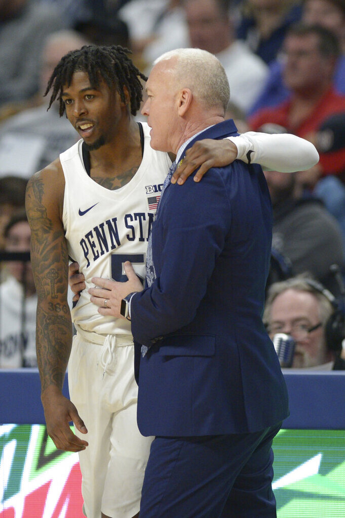 Penn State's Jamari Wheeler (5) shares a light moment with coach Patrick Chambers in the closing minutes of the the second half of an NCAA college basketball game against Northwestern, Saturday, Feb. 15, 2020, in State College, Pa. (AP Photo/Gary M. Baranec)