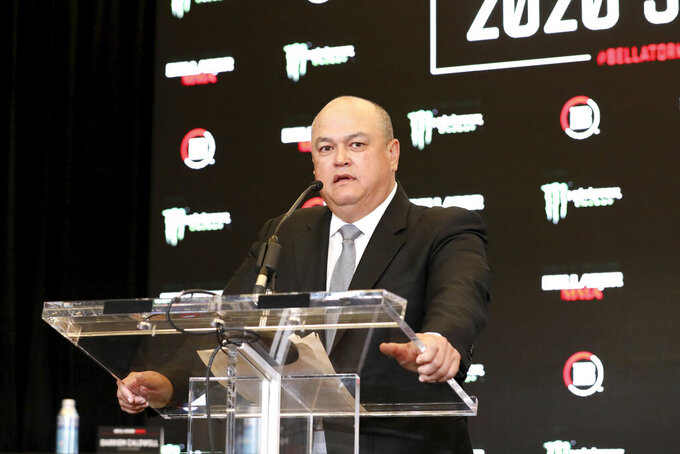 """FILE - In this Monday, March 9, 2020 file photo, Bellator President Scott Coker speaks at a news conference promoting the Bellator Spring & Summer fight cards in New York City.  Bellator President Scott Coker believes he put on some of the best fight cards in his promotion's history over the past two years while building a roster and a product capable of drawing attention across the world. The first of three consecutive weekly cards in April is headlined by a featherweight grand prix semifinal between champion Patricio """"Pitbull"""" Freire and Emmanuel Sanchez. (AP Photo/Gregory Payan, File)"""