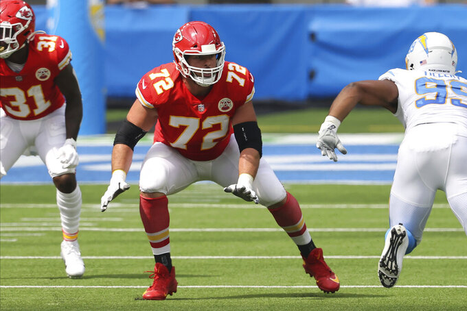 FILE - Kansas City Chiefs offensive tackle Eric Fisher (72) gets ready to block during an NFL football game between the between the Chiefs and Los Angeles Chargers in Inglewood, Calif., in this Sunday, Sept. 20, 2020,  file photo. Two people with direct knowledge have confirmed to The Associated Press the Indianapolis Colts have signed Eric Fisher to play left tackle. Kansas City selected Fisher with the No. 1 overall pick in the 2013 draft but the Chiefs released their longtime starter in March. (AP Photo/Peter Joneleit, File)