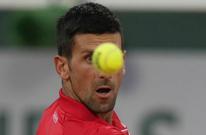 Serbia's Novak Djokovic plays a return to p United States's Tennys Sandgren during their first round match on day three of the French Open tennis tournament at Roland Garros in Paris, France, Tuesday, June 1, 2021. (AP Photo/Christophe Ena)