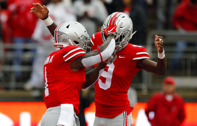 Ohio State receiver Johnnie Dixon, left, celebrates his touchdown against Rutgers with teammate Binjimen Victor during the first half of an NCAA college football game Saturday, Sept. 8, 2018, in Columbus, Ohio. (AP Photo/Jay LaPrete)