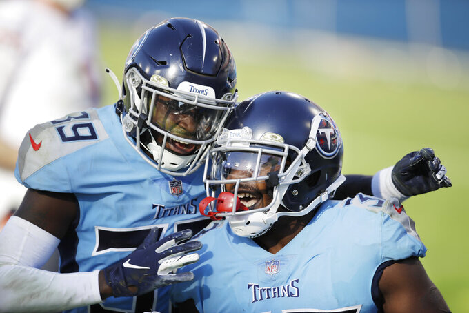 Tennessee Titans cornerback Desmond King, right, celebrates with Shaun Wilson (39) after King returned a fumble recovery 63 yards for a touchdown against the Chicago Bears in the second half of an NFL football game Sunday, Nov. 8, 2020, in Nashville, Tenn. (AP Photo/Ben Margot)