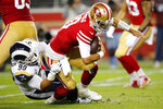 Los Angeles Rams defensive tackle Aaron Donald (99) sacks San Francisco 49ers quarterback Jimmy Garoppolo (10) during the second half of an NFL football game in Santa Clara, Calif., Saturday, Dec. 21, 2019. (AP Photo/John Hefti)