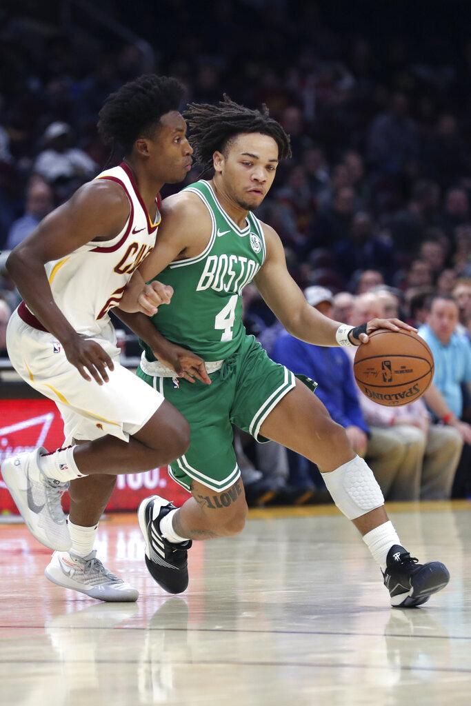Boston Celtics' Carsen Edwards (4) drives against Cleveland Cavaliers' Collin Sexton during the first half of an NBA preseason basketball game Tuesday, Oct. 15, 2019, in Cleveland. The Celtics defeated the Cavaliers 118-95. (AP Photo/Ron Schwane)