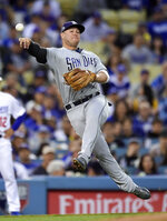 San Diego Padres third baseman Ty France attempts to throw out Los Angeles Dodgers' Corey Seager at first during the second inning of a baseball game Wednesday, May 15, 2019, in Los Angeles. Seager was safe at first on the play. (AP Photo/Mark J. Terrill)