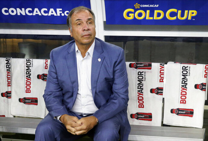 FILE - In this July 22, 2017, file photo, United States head coach Bruce Arena sits on the bench prior to a CONCACAF Gold Cup semifinal soccer match against Costa Rica, in Arlington, Texas. The New England Revolution have hired five-time MLS Cup winner and former U.S. national coach Bruce Arena as its coach and sports director. (AP Photo/LM Otero, File)