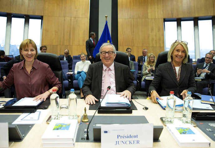 European Commission President Jean-Claude Juncker, center, chairs the weekly European Commissioners College meeting at EU headquarters in Brussels, Wednesday, Nov. 6, 2019. (AP Photo/Virginia Mayo)