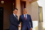 FILE - In this Dec. 23 2018 file photo, Italian premier Giuseppe Conte, left, poses with the head of the self-styled Libyan National Army Khalifa Hifter, in Benghazi, Libya. Various militias, many of which are little more than criminal gangs, are mobilizing to fight over the capital, Tripoli after Hifter launched a surprise offensive to retake Tripoli on April 5, 2019, from the transitional government supported by U.N. and Western nations led by Fayez Sarraj. Hifter's opponents view him as an aspiring dictator. (Libyan National Army Media Office via AP, File)