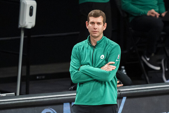 Boston Celtics head coach Brad Stevens looks on during the first half of Game 1 of an NBA basketball first-round playoff series against the Brooklyn Nets, Saturday, May 22, 2021, in New York. (AP Photo/Corey Sipkin)