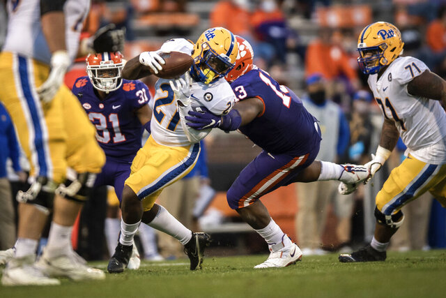 Clemson defensive tackle Tyler Davis (13) tackles Pittsburgh running back A.J. Davis (21) during the first half of an NCAA college football game Saturday, Nov. 28, 2020, in Clemson, S.C. (Ken Ruinard/The Independent-Mail via AP, Pool)