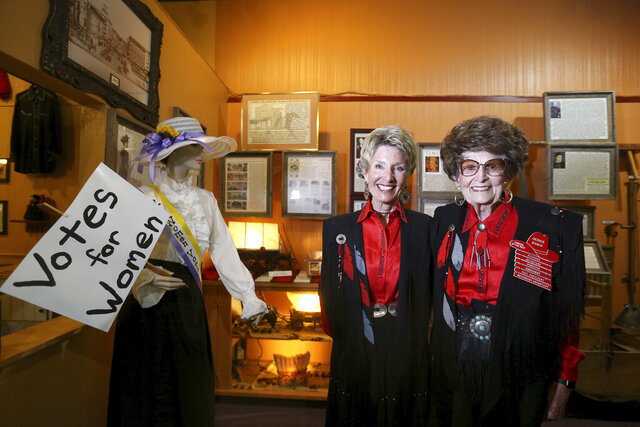 Cowgirls of the West Museum Director Pam Cooper, left, and museum co-founder Gerrie Bishop pose for a photo inside the museum on Wednesday, Sept. 2, 2020, in Cheyenne, Wyo. The museum is reopening on Saturdays amid efforts to keep it alive through the coronavirus pandemic. (Michael Cummo/The Wyoming Tribune Eagle via AP)