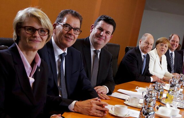 """FILE - In this Wednesday, March 14, 2018 file photo from left: German Science and Education Minister Anja Karliczek, Economic Cooperation and Development Minister Gerd Mueller, Labor Minister Hubertus Heil, Finance Minister Olaf Scholz, Chancellor Angela Merkel and Helge Braun, Head of the Chancellery, pose for the media during the constitutive cabinet meeting of the new German government at the chancellery in Berlin, Germany. Markus Soeder, the leader of the smallest party in Merkel's coalition, said in a weekend interview with the Bild am Sonntag newspaper that """"we should rejuvenate and renew the government team by the middle of the year"""" to give it new momentum. (AP Photo/Markus Schreiber, file)"""