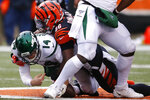 New York Jets quarterback Sam Darnold (14) is sacked by Cincinnati Bengals defensive end Carlos Dunlap (96) during the second half of an NFL football game, Sunday, Dec. 1, 2019, in Cincinnati. (AP Photo/Gary Landers)