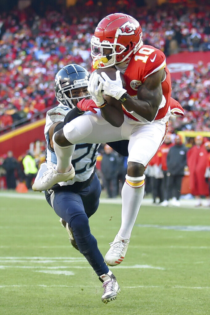 Kansas City Chiefs' Tyreek Hill catches a touchdown pass in front of Tennessee Titans' Logan Ryan during the first half of the NFL AFC Championship football game Sunday, Jan. 19, 2020, in Kansas City, MO. (AP Photo/Ed Zurga)