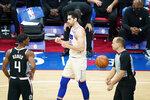 Philadelphia 76ers' Furkan Korkmaz, center, celebrates past Los Angeles Clippers' Rajon Rondo after a making basket during the second half of an NBA basketball game, Friday, April 16, 2021, in Philadelphia. (AP Photo/Matt Slocum)