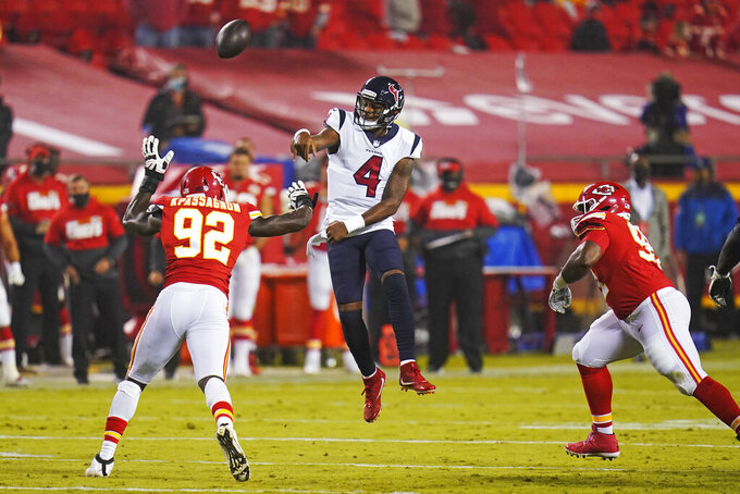 Houston Texans quarterback Deshaun Watson (4) throws over the reach of Kansas City Chiefs defensive end Tanoh Kpassagnon (92) in the first half of an NFL football game Thursday, Sept. 10, 2020, in Kansas City, Mo. (AP Photo/Jeff Roberson)