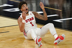 Utah's Timmy Allen (1) reacts after a play against Washington during the second half of an NCAA college basketball game in the first round of the Pac-12 men's tournament Wednesday, March 10, 2021, in Las Vegas. (AP Photo/John Locher)