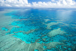 In this undated photo provided by the Great Barrier Reef Marine Park Authority, Hook Reef, in the Whitsunday region, is viewed from the air off the coast of Australia. Australia on Friday, July 23, 2021, garnered enough international support to defer for two years an attempt by the United Nations' cultural organization to downgrade the Great Barrier Reef's World Heritage status. (Jumbo Aerial Photography/Great Barrier Reef Marine Park Authority via AP)