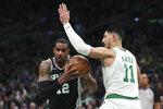 Boston Celtics center Enes Kanter (11) tries to block San Antonio Spurs center LaMarcus Aldridge (12) during the first half of an NBA basketball game Wednesday, Jan. 8, 2020 in Boston. (AP Photo/Charles Krupa)
