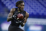 FILE - In this Feb. 27, 2020, file photo, Arizona State wide receiver Brandon Aiyuk runs a drill at the NFL football scouting combine in Indianapolis. Aiyuk was chosen by the San Francisco 49ers in the first round of the NFL draft. (AP Photo/Michael Conroy, File)