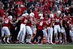 Nebraska players on the sideline celebrate late in the fourth quarter an NCAA college football game against Minnesota in Lincoln, Neb., Saturday, Oct. 20, 2018. (AP Photo/Nati Harnik)