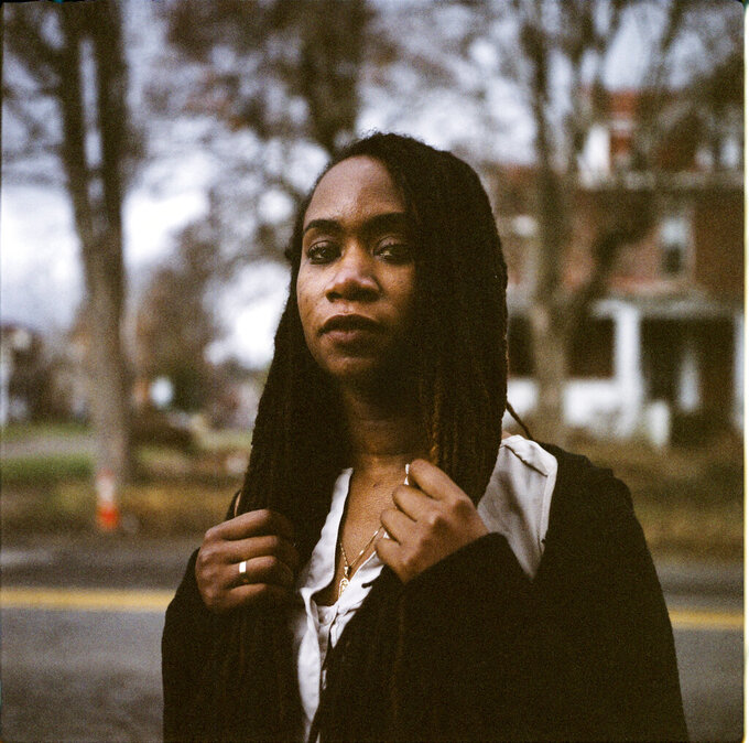 "In this photo made with a medium format film camera, Larrecsa Cox, 39, stands for a portrait in Huntington, W.Va., Thursday, March 18, 2021. Cox, a paramedic, leads the Quick Response Team that within days visits everyone who overdoses to try to pull them back from the brink. ""You're not in trouble,"" she says, gives them the overdose reversal medication naloxone and offers help navigating their way to recovery. Huntington was once ground-zero for this epidemic. It was a hard-fought battle, but it worked. The county's overdose rate plummeted. They wrestled down an HIV crisis. Then the pandemic arrived undid much of their effort. ""I can't believe we've lost all these people,"" said Cox. ""But sometimes, you just have to focus on the living."" (AP Photo/David Goldman)"