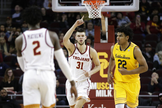 Southern California's Nick Rakocevic, center, celebrates his basket as he makes his way down the court past California's Andre Kelly during the second half of an NCAA college basketball game Thursday, Jan. 3, 2019, in Los Angeles. USC won 82-73. (AP Photo/Jae C. Hong)