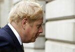 British Prime Minister Boris Johnson walks from 10 Downing Street to a meeting with his ministers at the Foreign Office, in London, Friday, Oct. 23, 2020. (AP Photo/Matt Dunham)